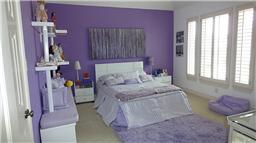 Lavender creates a calm atmosphere in the bedroom.